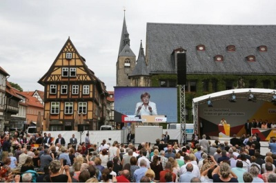 "alt=""Defiant Merkel takes on protestors at rowdy campaign rally"""