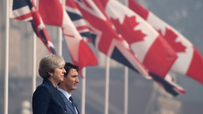 "alt=""Justin Trudeau, Theresa May pledge cooperation on Boeing, post-Brexit trade"""