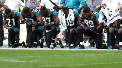 "alt=""'Take a knee': Athletes and celebrities protest after Donald Trump's tweets"""