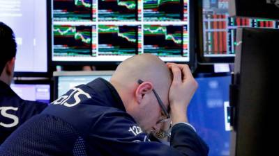 "alt=""Markets sell off, Dow plunges over 700 points as wild ride continues"""