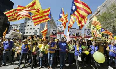 "alt=""Catalan protesters call for return of jailed or exiled leaders"""
