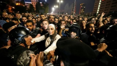 "alt=""Jordanians in third night of tax rise protests"""