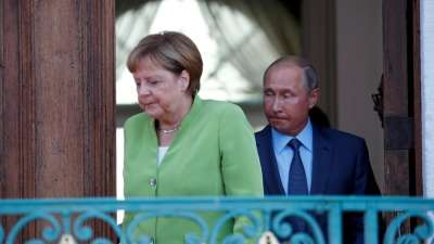 "alt=""Merkel, Putin tackle tough topics in meeting outside Berlin"""