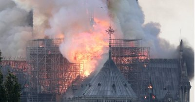 "alt=""Famed Notre Dame cathedral in Paris is ablaze, firefighters say"""