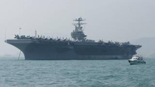 "alt=""US sends aircraft carrier and bomber task force to 'warn Iran'"""