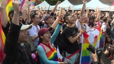 "alt=""Taiwan gay marriage: Parliament legalises same-sex unions"""