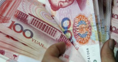 "alt=""China's currency is sending a warning signal about the trade war"""