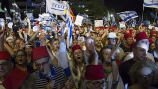 "alt=""Israel protests: Thousands rally against Netanyahu immunity"""