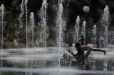 "alt=""Wildfires and power cuts plague Europeans as heatwave breaks records"""