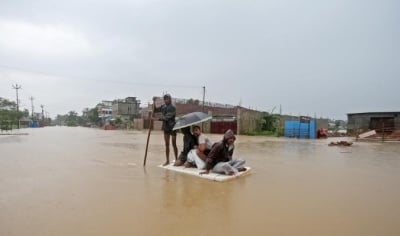 "alt=""Over 100 killed, millions displaced from floods in India, Nepal & Bangladesh"""