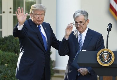 "alt=""Trump says Fed Chief Powell 'let us down' by not clearly signaling more rate cuts"""