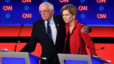 "alt=""Sanders & Warren Battle Accusations of 'Fairy Tale' Promises as Intraparty Rift Flares"""