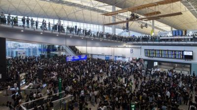 "alt=""Hong Kong protests cripple airport for second day"""