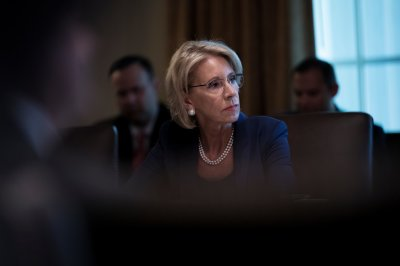 "alt=""DeVos Toughens Rules for Student Borrowers Bilked by Colleges"""