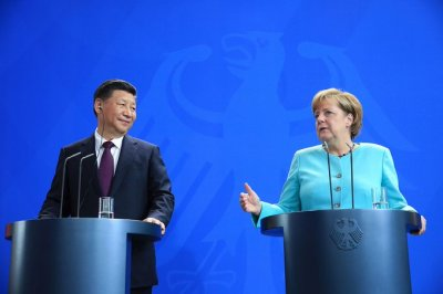 "alt=""Merkel Has Made a U-Turn on China But It May Be Too Late"""